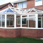 White upvc conservatory on brick house