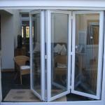 white bi folding doors