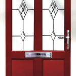 Red entrance door with decorative glass panels