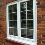 White aluminium windows on brick wall