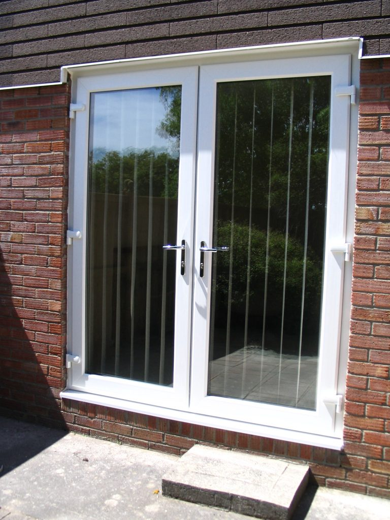 Double glazed patio doors french sliding or bi folding for Upvc balcony doors