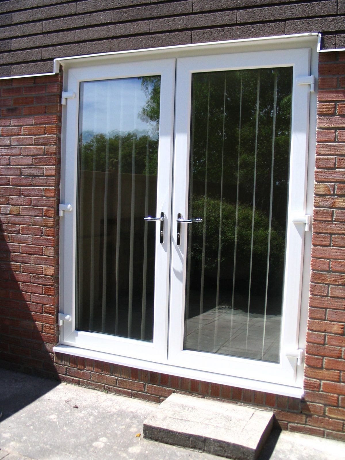 Double glazed patio doors french sliding or bi folding for Double opening patio doors