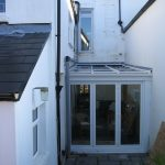 White upvc lean to conservatory with bi fold doors