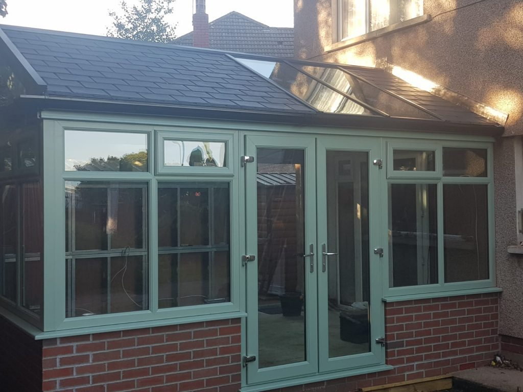 Green ultraframe solid roof conservatory