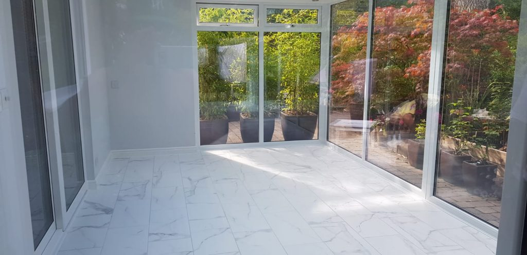 White glazed extension with marble flooring