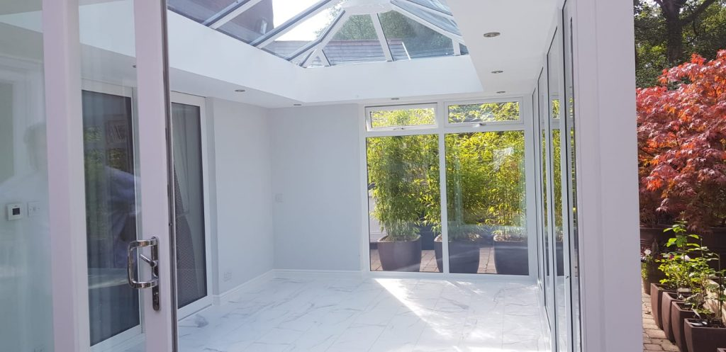Glazed extension with roof lantern white walls