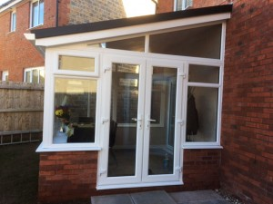 White lean-to with French door