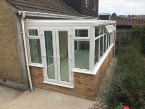 Conservatory-with-wihite-pvc-patio-doors